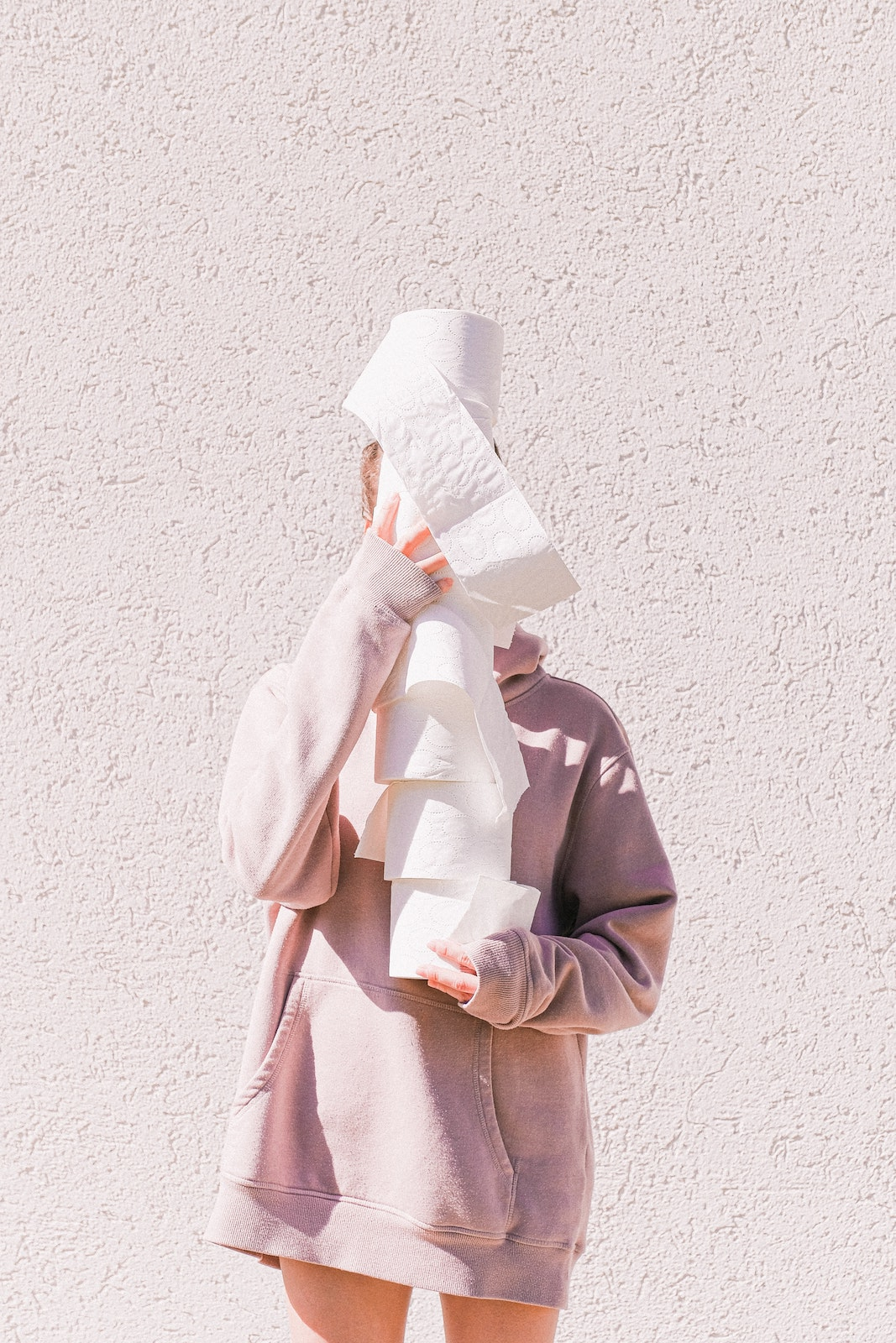 Person Carrying Tissue Rolls